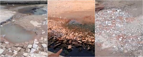 Moradores do Parque Brasil tampam buracos devido ausência do poder público